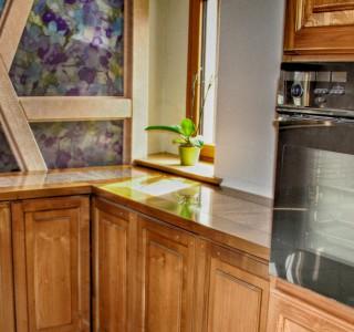 Küche mit neuen Massivholz Kirschbaumfronten